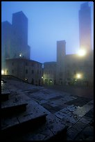 Piazza del Duomo at dawn in the fog. San Gimignano, Tuscany, Italy ( color)