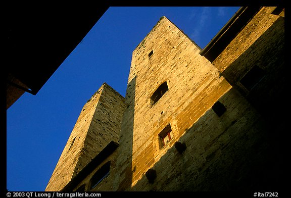 Medieval tower seen from the street, early morning. San Gimignano, Tuscany, Italy (color)