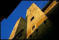 Medieval tower seen from the street, early morning. San Gimignano, Tuscany, Italy