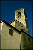 Massive shapes of the Duomo. San Gimignano, Tuscany, Italy