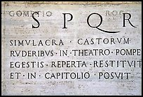 Inscription in Latin with the SPQR letters of the Ancient Roman Empire. Rome, Lazio, Italy (color)