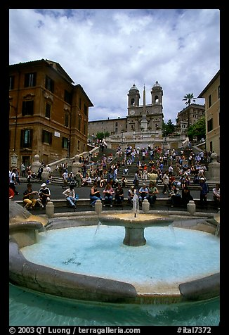 Fontana della Barcaccia and Spanish Steps covered with visitors sitting. Rome, Lazio, Italy (color)