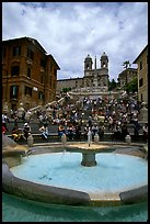 Fontana della Barcaccia and Spanish Steps covered with visitors sitting. Rome, Lazio, Italy