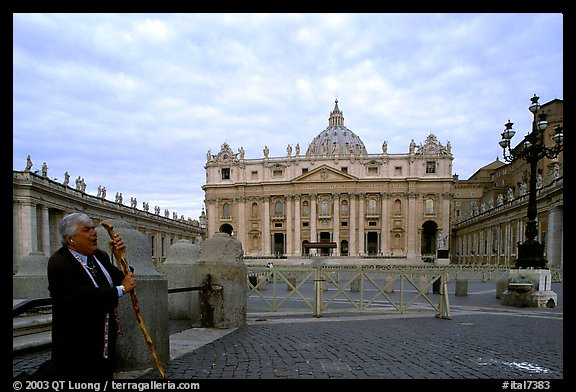 Pilgrim prays in front of the Basilic Saint Peter. Vatican City