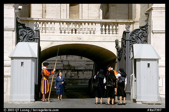 Nuns move past checkpoint manned by Swiss guards. Vatican City (color)