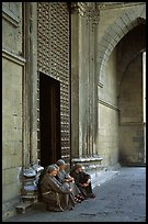 Nuns sit outside of one of  many churches of the historic town. Naples, Campania, Italy