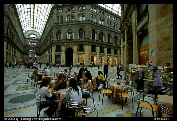 Women enjoy gelato inside the Galleria Umberto I. Naples, Campania, Italy (color)