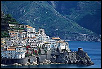 Houses built on a rocky promontory in Amalfi. Amalfi Coast, Campania, Italy