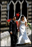 Newly wed couple on the stairs of Duomo Sant'Andrea, Amalfi. Amalfi Coast, Campania, Italy