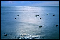 Small boats at sunset in the Gulf of Salerno, Positano. Amalfi Coast, Campania, Italy