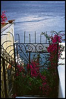 Forged metal entrance to a garden overlooking the sea, Positano. Amalfi Coast, Campania, Italy