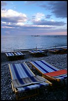 Beach chairs on Spiaggia del Fornillo at sunset, Positano. Amalfi Coast, Campania, Italy