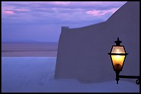 Lamp, White walls, pastel colors of sunset, Positano. Amalfi Coast, Campania, Italy