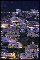 Houses on steep hill at sunset, Positano. Amalfi Coast, Campania, Italy