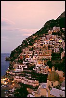 Positano at dawn, with the ceramic dome of Chiesa di Santa Maria Assunta in the foreground. Amalfi Coast, Campania, Italy