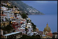 Chiesa di Santa Maria Assunta and houses on steep hills at dusk, Positano. Amalfi Coast, Campania, Italy
