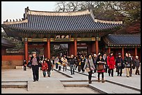 People walking down gate, Changdeok Palace. Seoul, South Korea ( color)