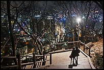 Couple walking down Namsan stairs by night. Seoul, South Korea (color)
