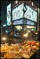 Street food vendor and cosmetics store by night. Seoul, South Korea ( color)