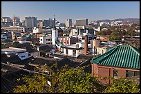 Hanok houses overlooking modern skyline. Seoul, South Korea (color)