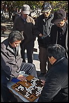Elderly men play game of baduk (go). Seoul, South Korea (color)