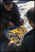 Pondering moves in go (baduk) game. Seoul, South Korea ( color)