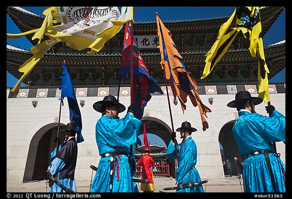 Guards carrying flags in front of main gate, Gyeongbokgung. Seoul, South Korea (color)