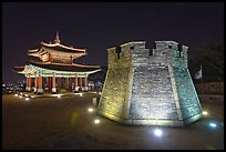 Crossbow tower and command post at night,  city lights, Suwon. South Korea