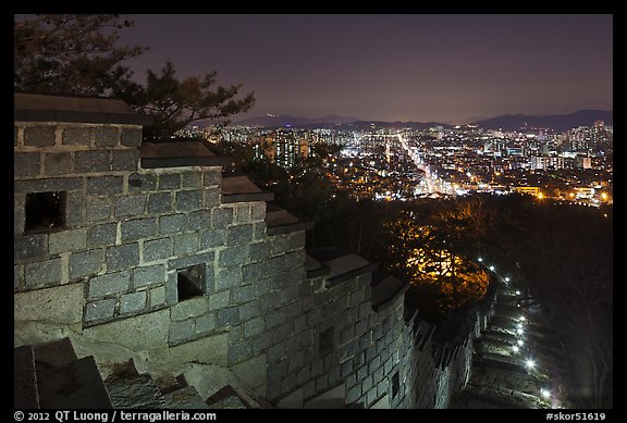 Rampart wall and city lights, Suwon Hwaseong Fortress. South Korea (color)