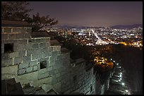 Rampart wall and city lights, Suwon Hwaseong Fortress. South Korea