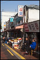 Shopkeepers and storefronts. Daegu, South Korea (color)