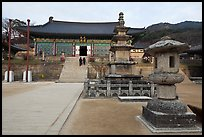 Three-story stone pagoda and main hall, Haeinsa Temple. South Korea