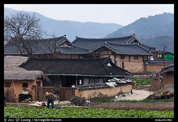 Picture photo villager tending to fields in front of for Houses in south korea