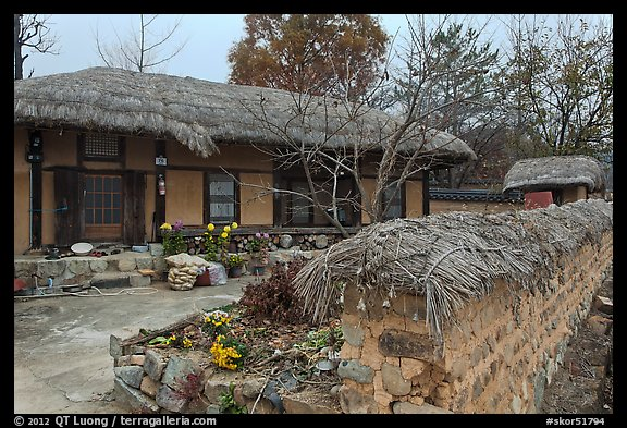 House and fence with straw roofing. Hahoe Folk Village, South Korea