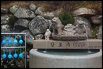 Water fountain and drinking cups, Seokguram. Gyeongju, South Korea (color)