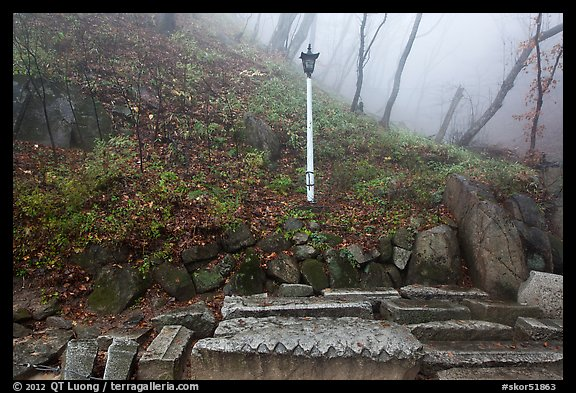Stones and lantern in fog, Seokguram. Gyeongju, South Korea (color)