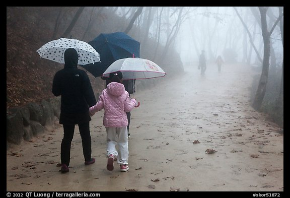 Family walking on misty path, Seokguram. Gyeongju, South Korea (color)