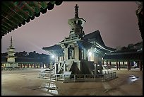 Main courtyard with pagodas by night, Bulguk-sa. Gyeongju, South Korea ( color)