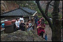 Hikers drinking from foundtain at Sangseonam hermitage, Namsan Mountain. Gyeongju, South Korea ( color)