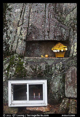 Shrine with candles and flowers, Mt Namsan. Gyeongju, South Korea (color)