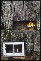 Shrine with candles and flowers, Mt Namsan. Gyeongju, South Korea ( color)