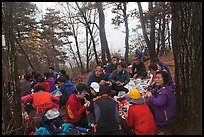 Large group of hikers eating on Geumobong Peak, Namsan Mountain. Gyeongju, South Korea (color)