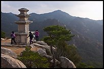 Women circling stone pagoda, Mt Namsan. Gyeongju, South Korea (color)