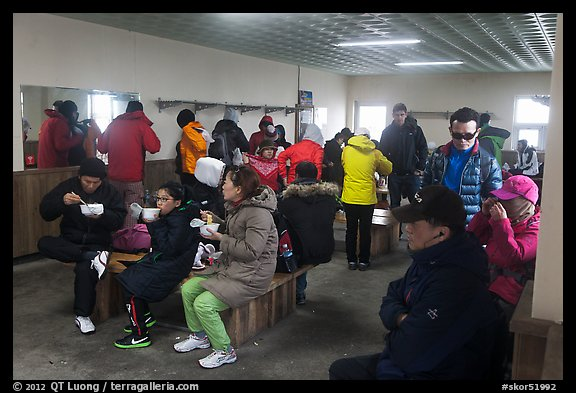 Hikers eating noodles inside Witseoreum shelter, Hallasan. Jeju Island, South Korea (color)
