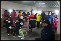 Hikers eating noodles inside Witseoreum shelter, Hallasan. Jeju Island, South Korea ( color)