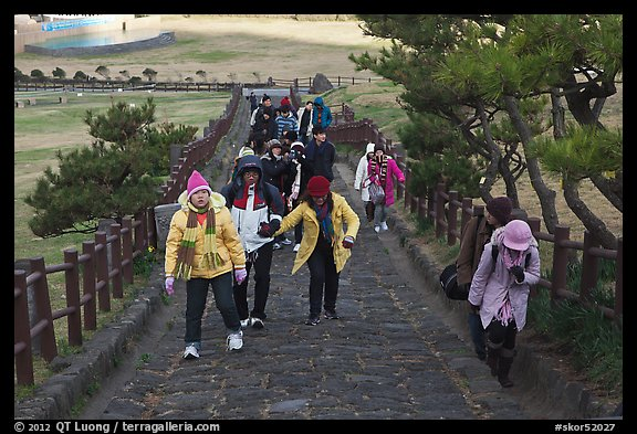 Tourists walking up path, Ilchulbong. Jeju Island, South Korea (color)