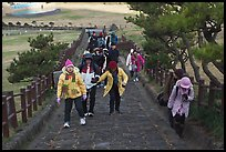 Visitors walking up path, Ilchulbong. Jeju Island, South Korea (color)