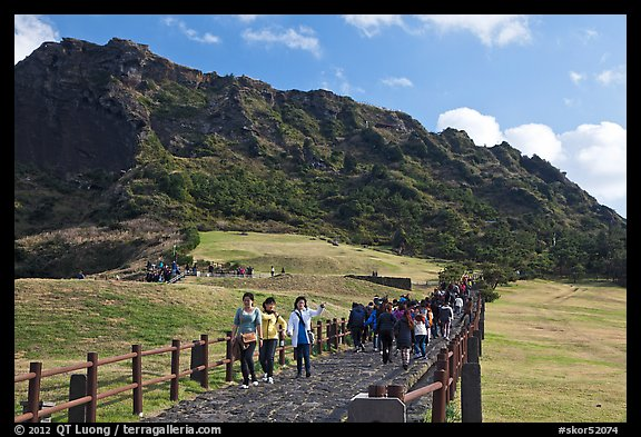 Seongsang Ilchulbong and visitors on path. Jeju Island, South Korea