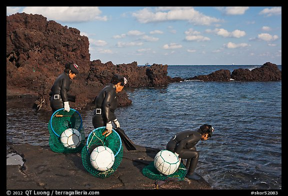 Old Haeneyo women preparing for dive. Jeju Island, South Korea (color)