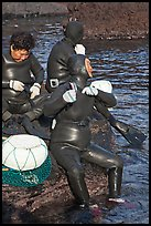 Haeneyo women arranging wetsuits. Jeju Island, South Korea (color)